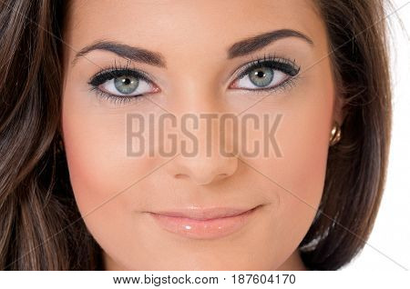 Close-up portrait of beautiful young woman or young girl with opened eyes - make-up