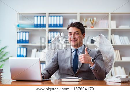 Angel investor concept with businessman and wings