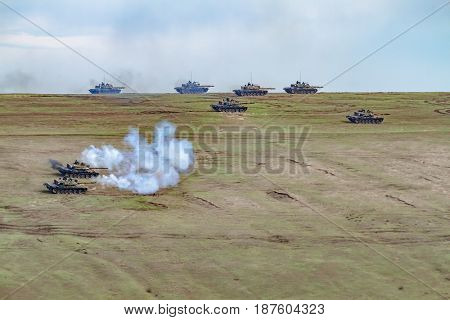 Romanian tanks fire during the NATO 'Wind Spring 15' military exercise in the Smardan range of Galati County on April 21, 2015.