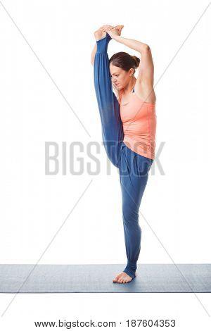 Woman doing Yoga asana Utthita hasta padangustasana C - hand to toe pose C isolated on white background