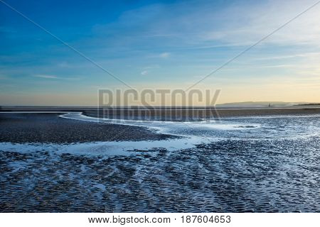 Camber Sands beach in spring at low tide at dusk, East Sussex, England, U.K