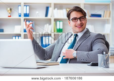 Businessman playing virtual guitar in office