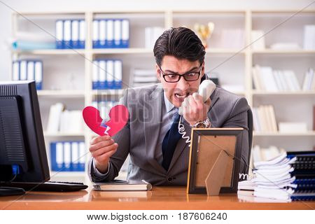 Businessman in saint valentine concept in office
