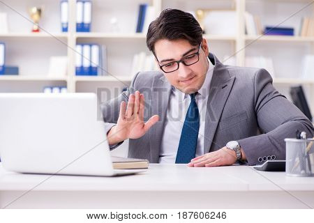 Businessman playing drums in office