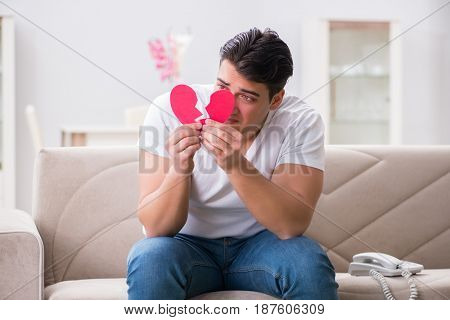 Young man in sad saint valentine concept