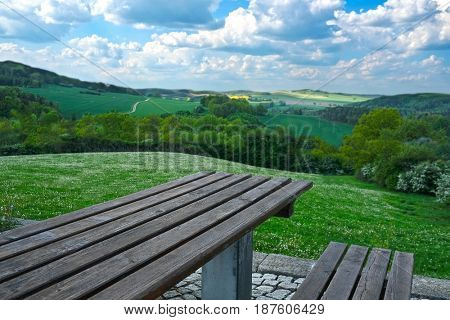 Spring wooden-steppe landscape wityh wooden table on a front ground