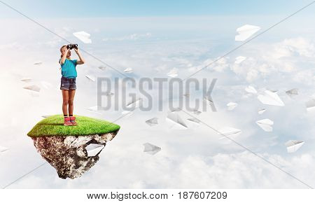 Cute smiling girl on floating island high in sky