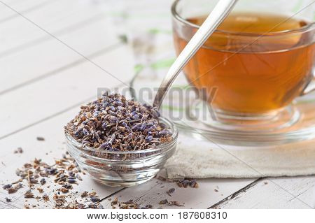 Aromatic lavender tea and bunch of dried lavender. Toned image
