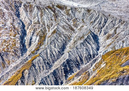 Aerial view of Alaska mountains glacier ridges texture. Closeup of rock sediments on mountain ridges, wilderness nature travel adventure.