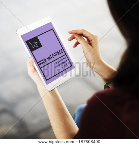 Woman using digital tablet with digital text