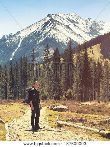 Tourist On Natural Mountain Background