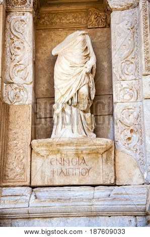 Statue in front of the Celsus Library, Ephesus, Selcuk, Lycia, Turkey,