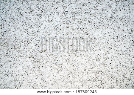An abstract image of an old white painted stucco wall.