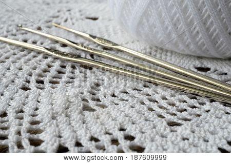 A close up image of a white crochet doily.
