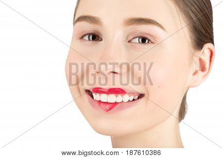 Woman with a natural beauty makeup look - isolated over a white background with copyspace