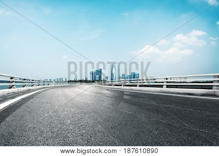 empty road with landmark buildings in suzhou