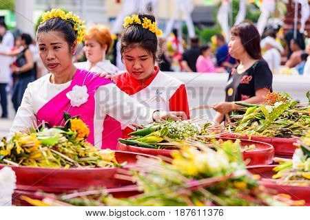 CHIANG MAI THAILAND - MAY 22 : Crowd of people worshiping offering flowers attended a ceremony to worship the city pillar (Inthakin Festival) at Chedi Luang temple on May 22 2017 in Chiang mai Thailand.