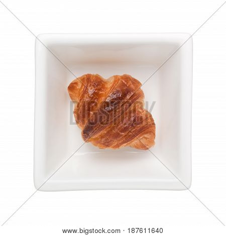 Mini croissant in a square bowl isolated on white background