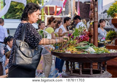 CHIANG MAI THAILAND - MAY 22 : People worshiping offering flowers attended a ceremony to worship the city pillar (Inthakin Festival) at Chedi Luang temple on May 22 2017 in Chiang mai Thailand.