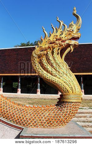 nine head naga mounted on the ladder in Thai temple