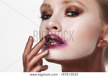 Cosmetics, makeup and beauty concept: young woman with bright make up