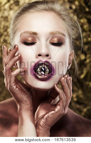 Beautiful girl with bright make up. Blonde with jewerly.