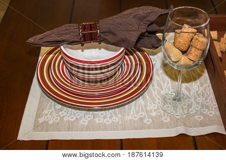 Plates, Bowl, Napkin And Wine Glass Place Setting