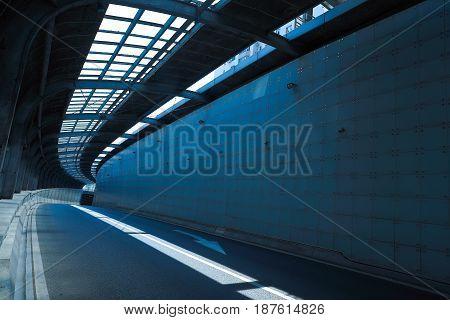 Empty road surface floor in tunnel inside