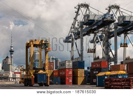 AUCKLAND, NEW ZEALAND - OCTOBER 2, 2015: Auckland port with container cranes and shipping freight containers