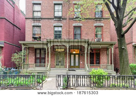 New York City - April 30, 2017: House on Astor Row. Astor Row is the name given to 28 row houses on the south side of West 130th Street between Fifth and Lenox Avenues in the Harlem neighborhood of Manhattan New York City