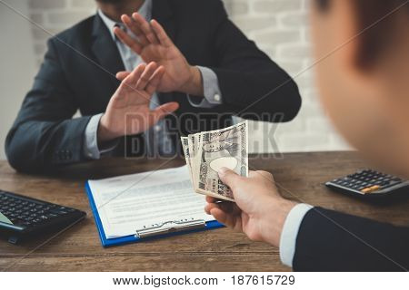Businessman refusing money - anti bribery and corruption concepts