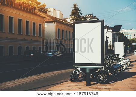 Square information board with road and crosswalk around empty rectangular banner mock-up with bicycle parking behind blank billboard with copy space place for advertising message or your logo