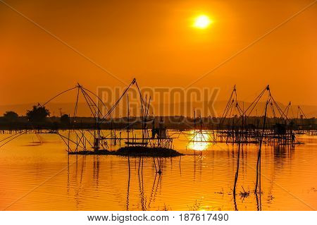 Traditional fishing tools in swamp during sunset