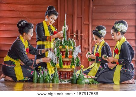 NAKORN PHANOM THAILAND - FEBRUARY 14 2015: Thai northeastern Phutai traditional liftstyle in making rice offering and garland for Phutai world cerebration event in Renunakorn of Nakorn Phanom Thailand.