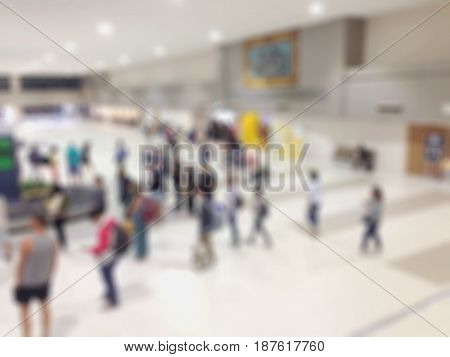Abstract blur waiting area for luggage in passenger termina in the airport interior for background.
