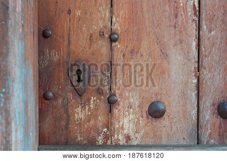 Heart Shaped Keyhole Surround In Old Wooden Door.
