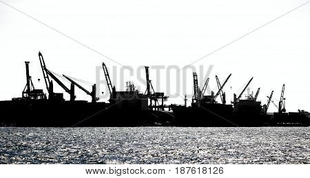 Harbor Cranes In Silhouette