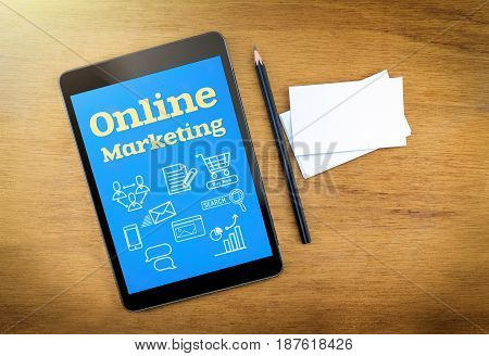 Online Marketing On Mobile Device Screen With Pen And Business Card On Wood Table,digital Marketing