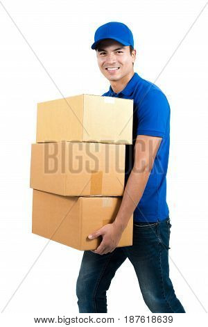 Smiling delivery man holding boxes - isolated on white background