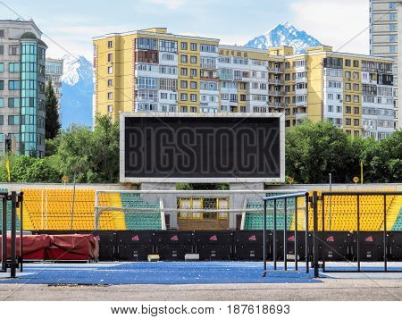 ALMATY KAZAKHSTAN - MAY 21 2017: Electronic scoreboard on The Central Stadium in the historic centre of Almaty city Kazakhstan. Almaty is the largest city in Kazakhstan and was the country's capital until 1997.