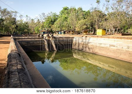 Ancient bathing tanks or ponds in the ruins of the ancient city of Anuradhapura Sri Lanka.