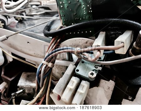Used Old Electronic Printed Circuit Board with Connected Electrical Power Wires.
