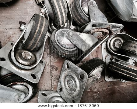Old and Used Industrial Wheels or Caster Wheels with Metal Legs and Rubber Roller.