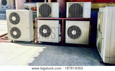 Outdoor unit split Air Compressor or Air Conditioner Condenser being installed in an open area.