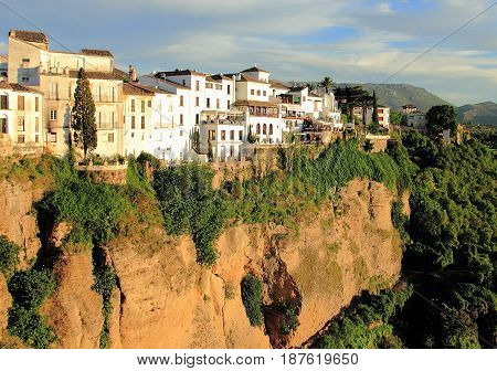 Ronda, Spain. Beautiful view on the town and El Tajo canyon before sunset.