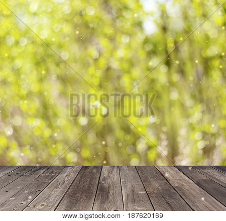 Empty wooden deck on spring blurred background with bokeh. Empty space for Your subject.