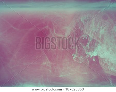 Abstract colored background. Colored smoke, ink in water, the patterns of the universe. Abstract movement, frozen multicolor flow of paint. Horizontal photo with soft focus, blurred backdrop.