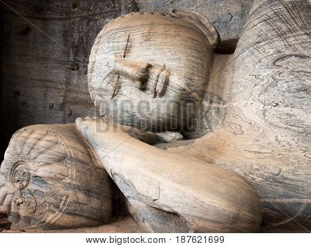 The reclining figure of buddha at Gal Vihara Polonnaruwa Sri Lanka. One of the best examples of ancient sinhalese sculpture.