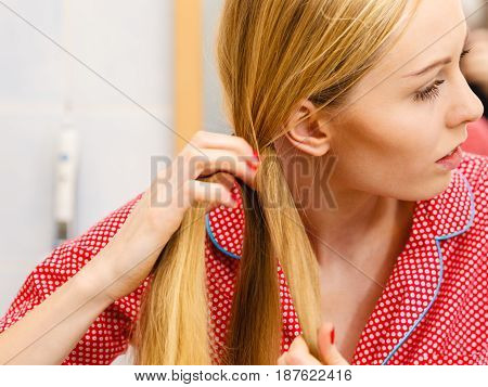 Woman Doing Braid On Blonde Hair