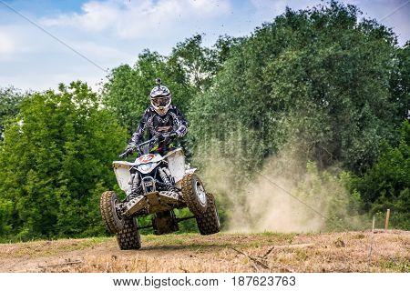 Atv Rider In Dirt Bike Jumping Action